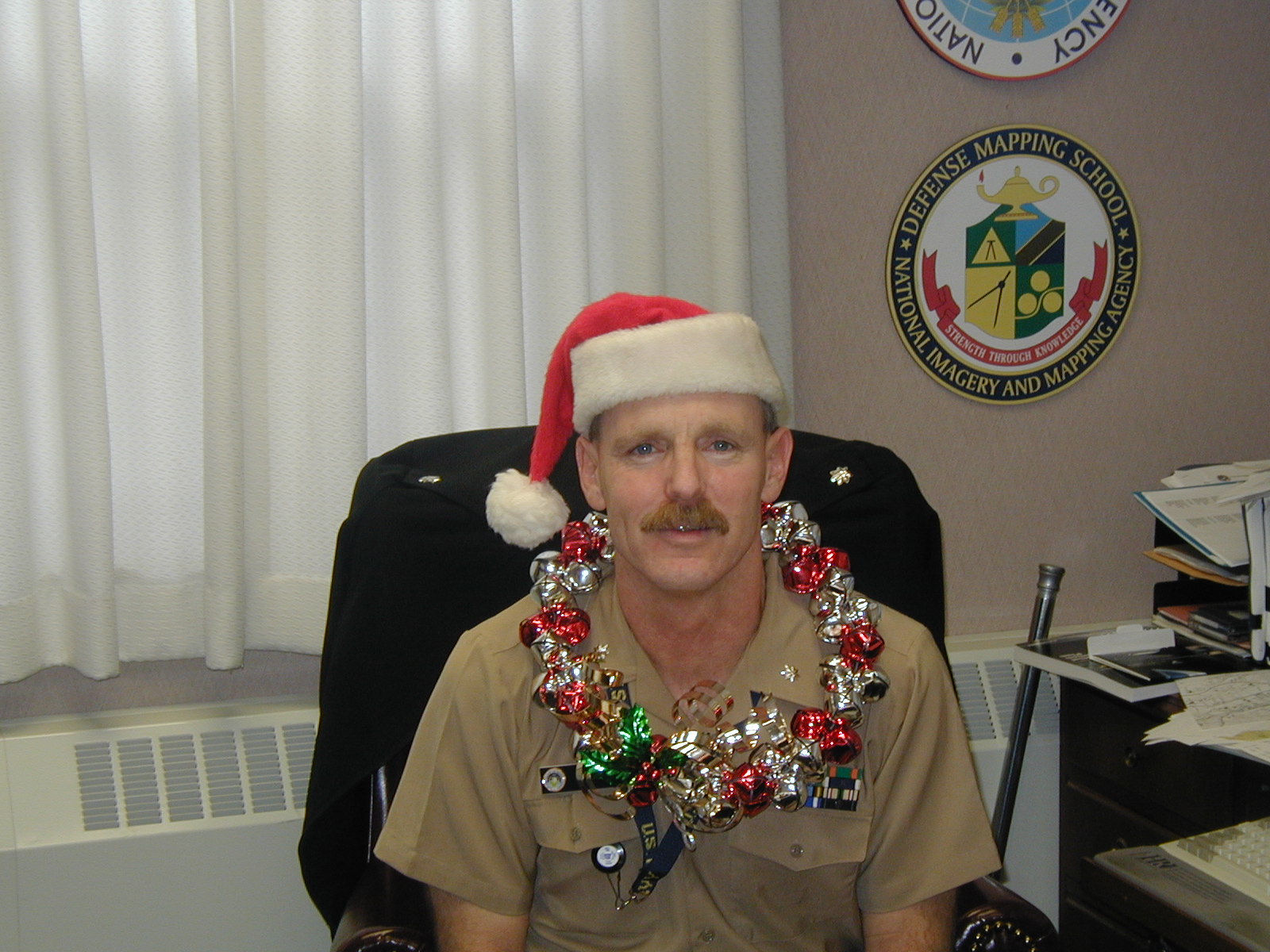 Commander Dan Taube, one of our navy's best trying out a potential new uniform - we hope the season was Christmas.
