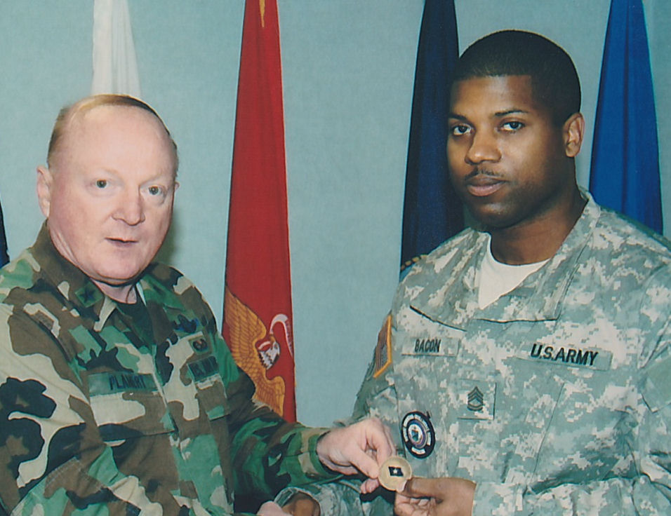 General Planert recognizing SFC Bacon with a challenge coin
