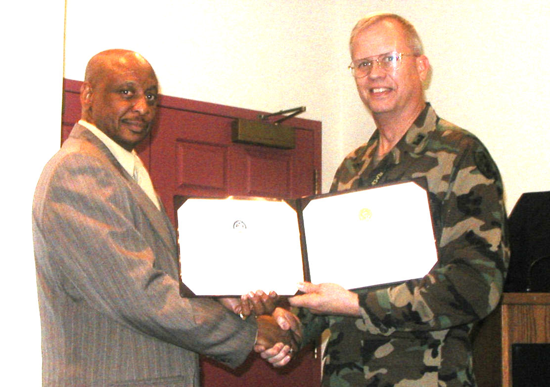 MSG(Ret) Wesley Bohannan receiving his well earned civilian retirement certificate and certificate of appreciation from COL Slusar in 1999. Bo also retired from the school when in the military.