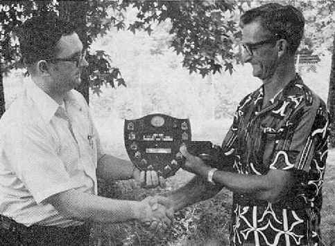Billy Peoples receiving meaningful gift from Wayne Ethridge showing the history of his military career - circa: 1975