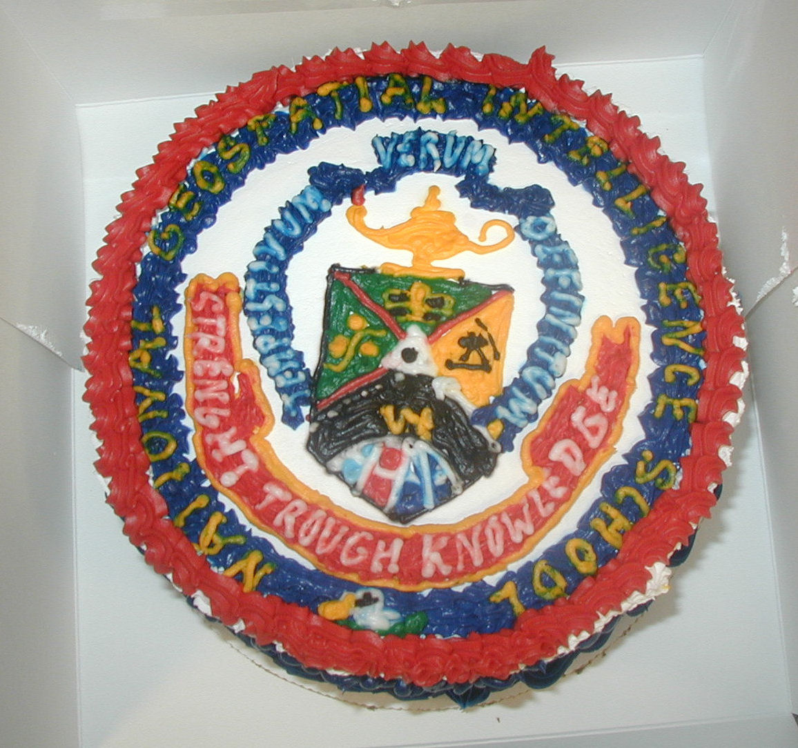 "This turned out to be kind of a farce as it is a picture of a cake at one of our Biggest celebrations- the school motto was ""Strength through Knowledge"" and the cake folks screwed up both words - Tasted a lot better then it looked."
